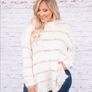 Long off white sweater with rainbow stripes